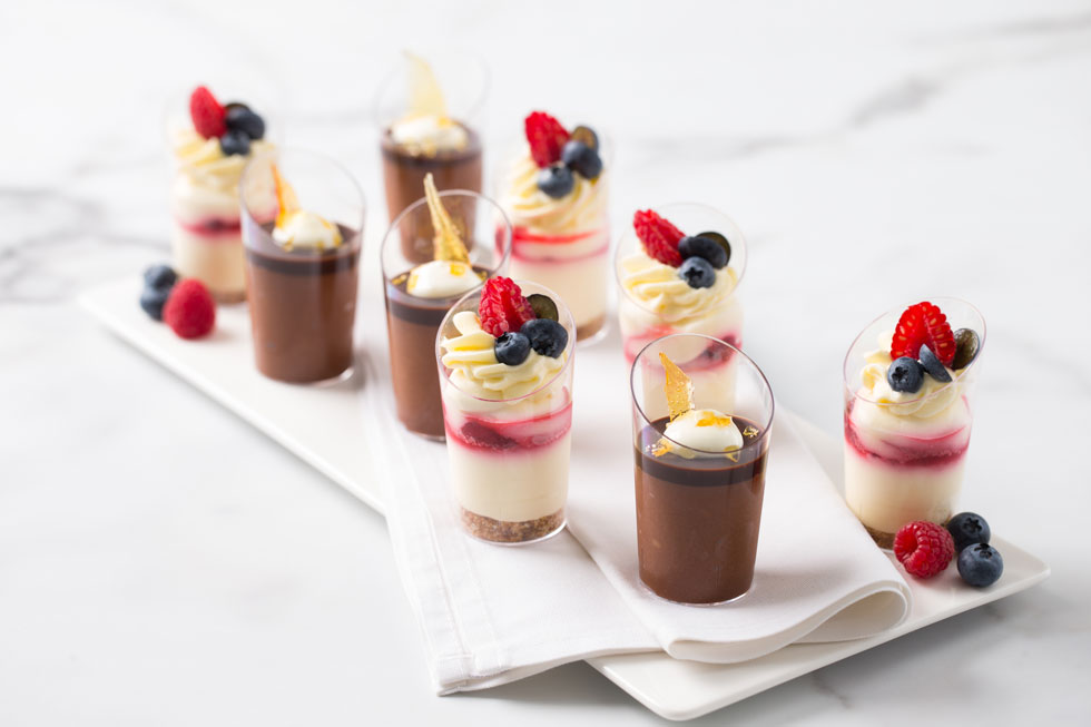 Mini Berry Cheesecake Shots w/ cream and seasonal fresh berries + Belgium Chocolate Mousse Shots w/ cream and salted caramel toffee shard